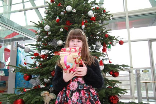Hannah Robinson with gifts for other children at Christmas