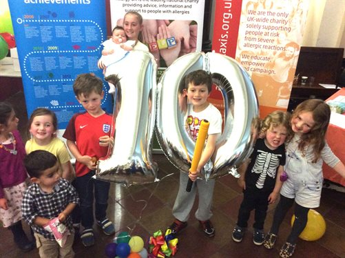 Children celebrating 10 years of the allergy service