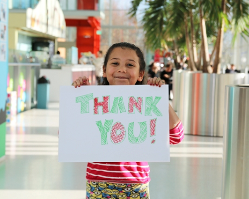 Girl with a thank you card