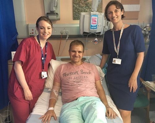 Patient Paul Alexander with PICU staff who saved his life