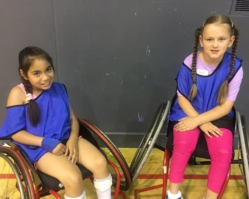 Catalina Diaz Gomez and Skye McWalter at a wheelchair basketball event