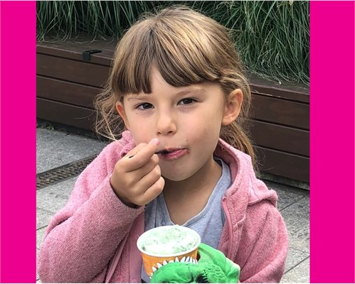 Six year old Emily Pratt who has benefitted from the peanut study eating ice cream