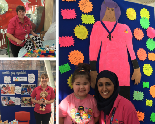 Play specialists at an exhibition to celebrate play in hospital week and a young girl with a painting of a play specialist