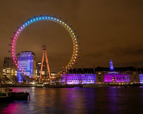 The London Eye lit up in Evelina London colours