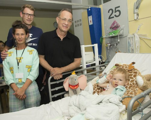 Tom Hanks visiting baby Roman and family at his hospital bed.