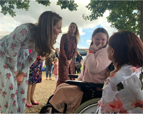 The Duchess of Cambridge meeting patient Louise at an outdoor event