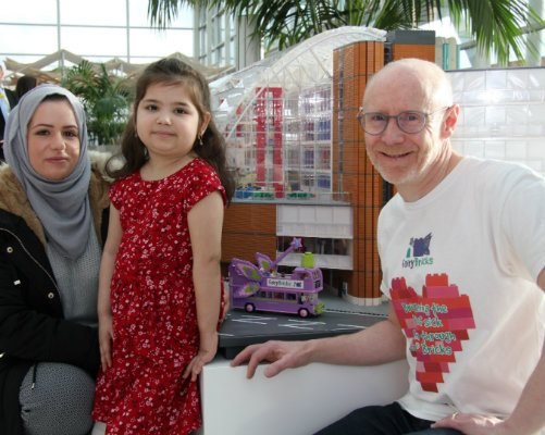 One of our young patients with her mother and the designer of our hospital's LEGO model