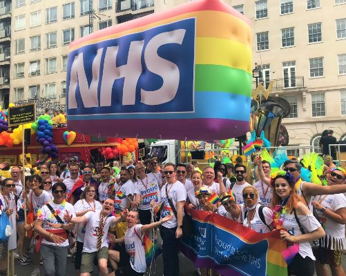 A NHS Rainbow Badge shaped blimp at the Pride parade in London