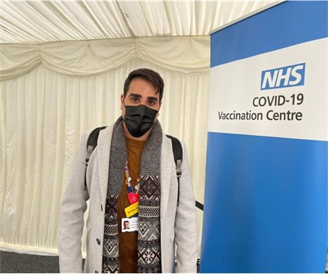 Dr Ranj vaccine with a sign that says NHS COVID-19 Vaccination Centre