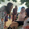 The Duchess of Cambridge in a garden with an Evelina London patient.