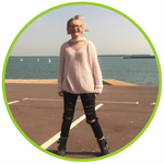 Tilly Moore, an arthritis patient at Evelina London, standing in front of the sea.