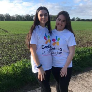 Amelia with her friend in the countryside wearing Evelina London t-shirts.
