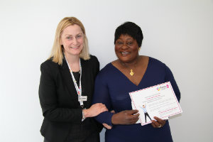 One of our Evelina 150 stars holding her certificate with Miranda Jenkins, Director of Strategy