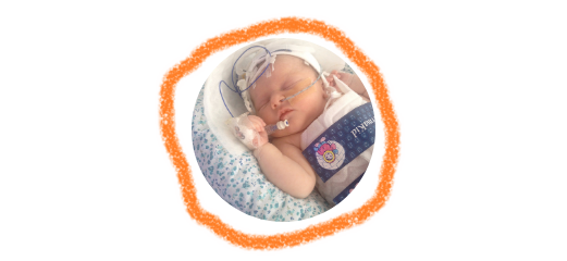 A header image with a newborn wearing a cooling jacket surrounded by ring of orange crayon