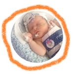 Baby in a cooling jacket with crayon line surrounding the circular image.