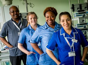Group of male and female nurses posed in a line in picu