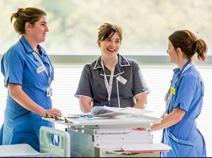 Three PICU nurses working together