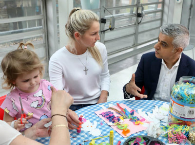 Mayor of London with a little girl and her mum