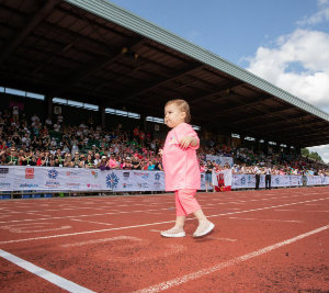 Mia crossing the finishing line at the British Transplant Games