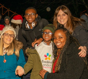 Tourae with his mum, brother and Evelina London staff.