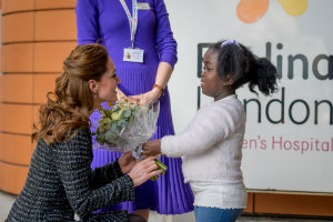 HRH The Duchess of Cambridge being greeted by Anna-Victoria, an Evelina London patient.