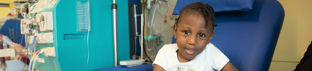 Young boy sat in a chair having dialysis