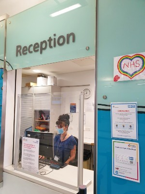 Our reception at Evelina London. A member of staff is wearing a face mask.